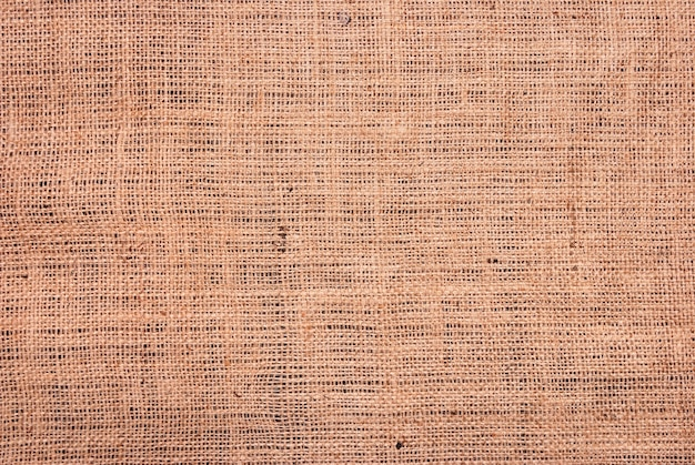 Fragment van ruwe bruine textielachtergrond