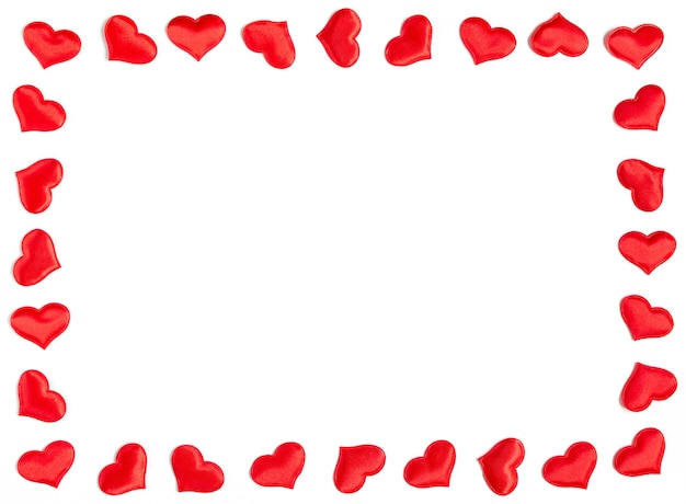 Frame gemaakt van rode harten geïsoleerd op een witte achtergrond, valentijnsdag concept.