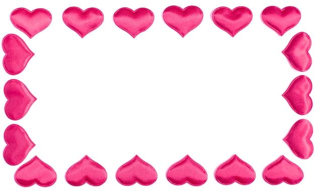 Frame gemaakt van roze harten geïsoleerd op een witte achtergrond, valentijnsdag concept.
