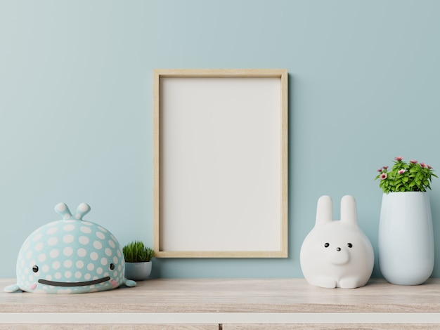 Frame leeg in kinderkamer interieur en blauwe muur.