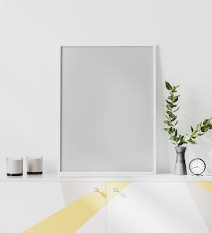 Frame op witte commode met grijze en gele print, vaas met bladeren en kaarsen en witte muur, leeg posterframe mockup, 3d-rendering