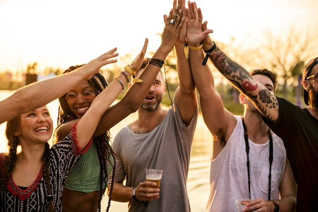 Friends hands together unity bij festival event