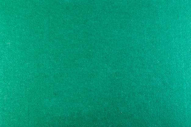 Full-frame opname van groene pokertafel