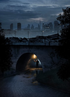 Full shot man onder brug met licht