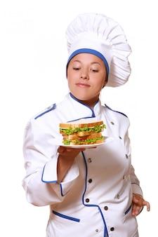 Funy chef-kok vrouw op wit