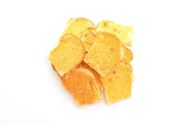 Gebakken knapperig brood met geïsoleerde boter en suiker
