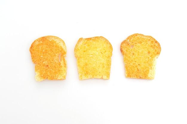 Gebakken krokant brood met boter en suiker geïsoleerd op een witte ondergrond