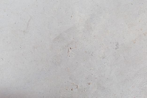 Gebarsten concrete uitstekende muurachtergrond, oude muur - beeld
