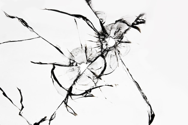 Gebarsten gebroken glas, de textuur van een gebarsten voorruit door een steenslag of een kogel