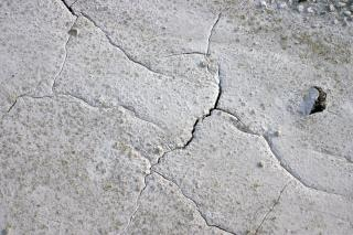Gebarsten modder oppervlak, scheuren