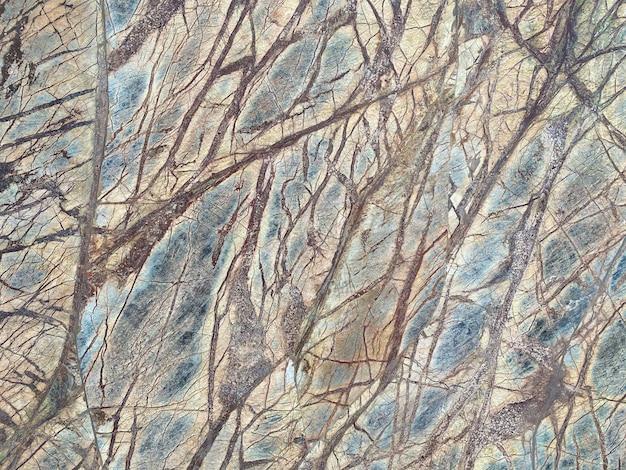 Gebarsten oude grijze stenen muur textuur achtergrond