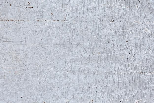Gebarsten oude verf textuur achtergrond. met vier lange scheuren