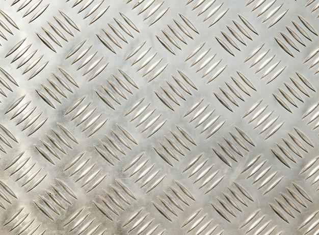 Geborsteld metalen textuur; abstracte industriële achtergrond