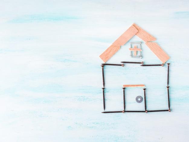 Gebouw huis concept plat lag met schroef en hout