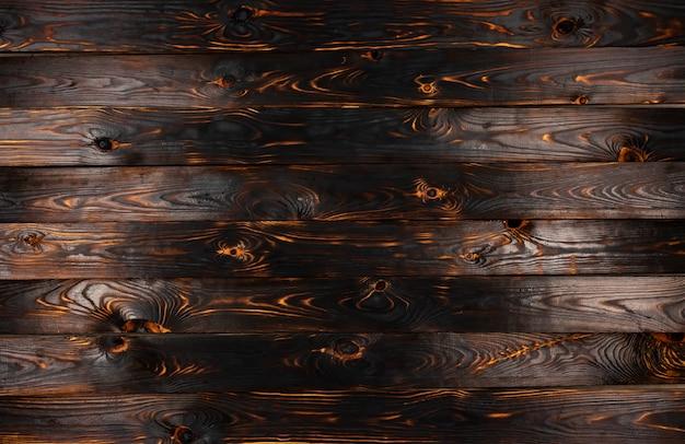 Gebrande houten textuurachtergrond