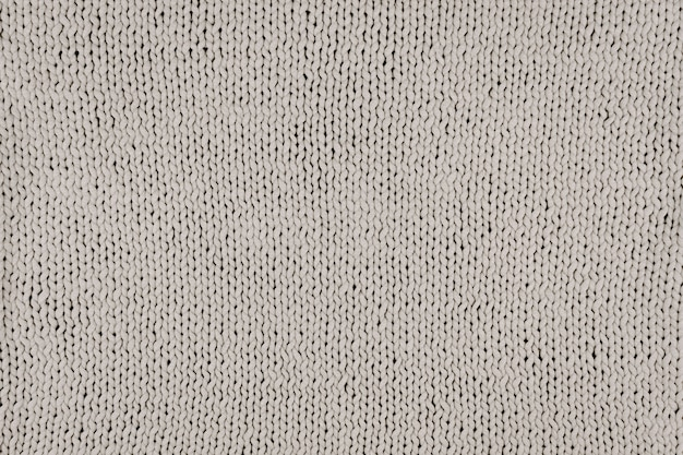 Gebreide t-shirt garen gebreide achtergrond. grijze gebreide stoffentextuur