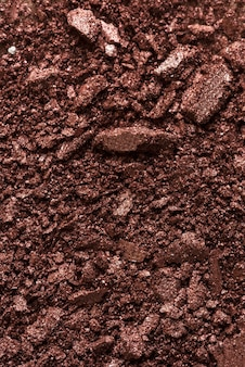 Gebroken bronzer make-up poeder achtergrond