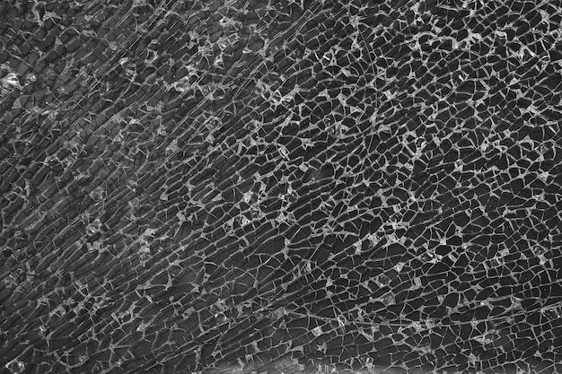 Gebroken glas, achtergrond van gebarsten raam. gebroken glas textuur. geïsoleerd realistisch gebarsten glaseffect, conceptelement.
