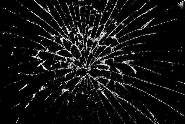 Gebroken glas, verbrijzeld glas op zwart als achtergrond