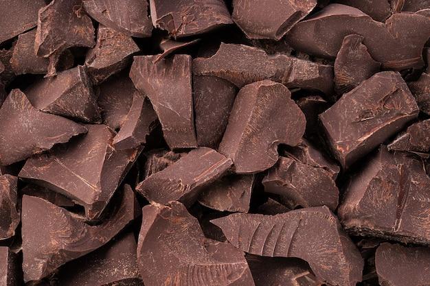 Gebroken repen donkere chocolademuur, dessertvoedsel