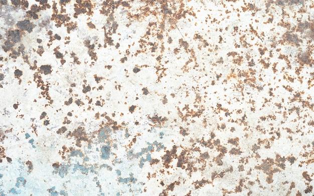 Gecorrodeerde metalen achtergrond geroeste grijs geverfde metalen muur roestige metalen achtergrond met roestvlekken roestvlekken het metalen oppervlak roestige plekken roestige corrosie