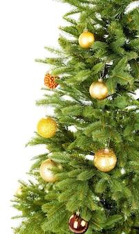 Gedecoreerde kerstboom close-up geïsoleerd op white