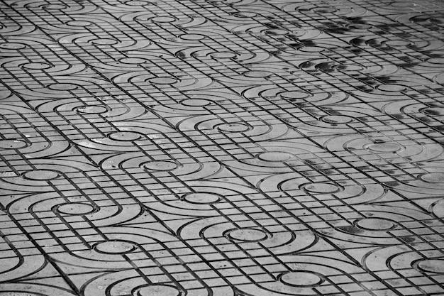 Gedessineerde straat tegels, oude cement bakstenen vloer achtergrond