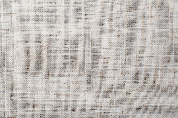 Gedetailleerde jute van de close-up uitstekende oude geweven stof, rustiek in bruin