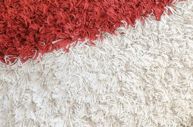Gedetailleerde tapijtachtergrond met witte en rode kleuren