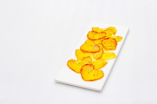 Gedroogde plakjes persimmon