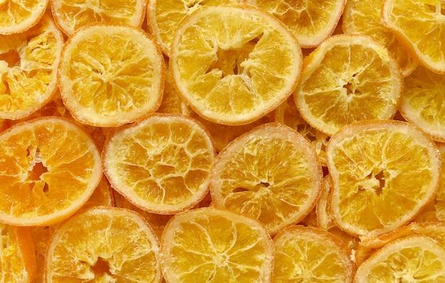 Gedroogde sinaasappelschijfjes achtergrond, gezonde maaltijd snack