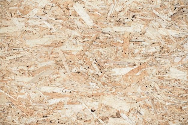 Gedrukte houten paneelachtergrond, naadloze textuur van georiënteerde bundelraad - osb