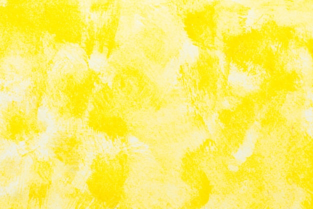Geel abstract waterverf schilderij getextureerd op witte achtergrond