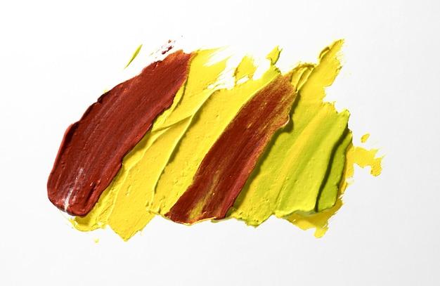 Geel en bruin penseelstreek concept