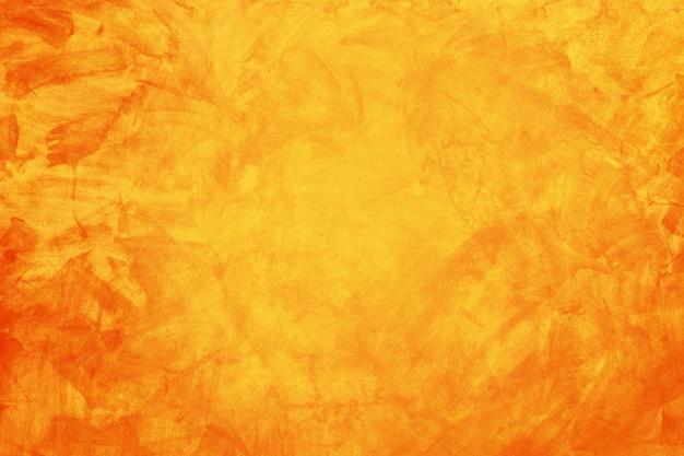 Geel en oranje grunge textuur cement of betonnen muur banner, lege achtergrond