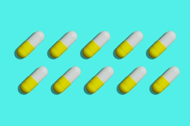 Geel en wit pillen achtergrond bovenaanzicht pillen patroon