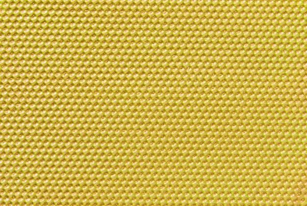 Geel gekleurde honingraatachtergrond