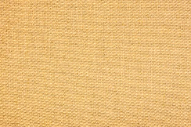 Geel gekleurde naadloze linnen textuur of stof canvas achtergrond.