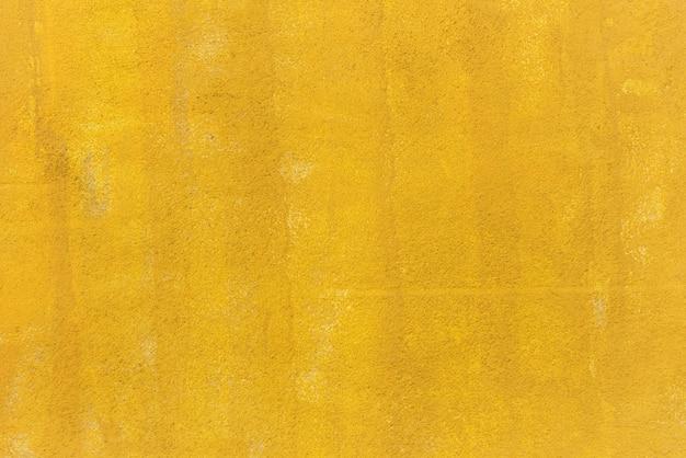 Geel geschilderde muur achtergrond