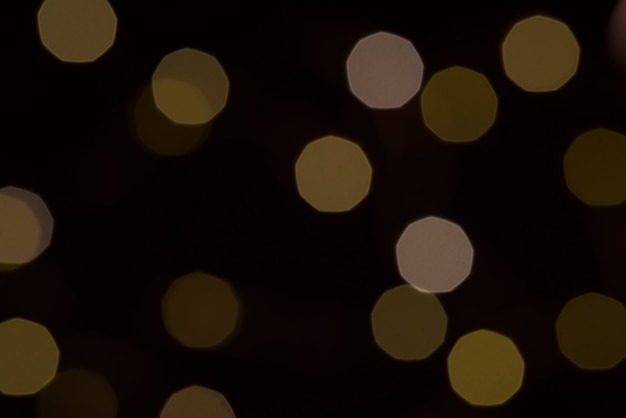 Geel glitter boke textuur op zwart
