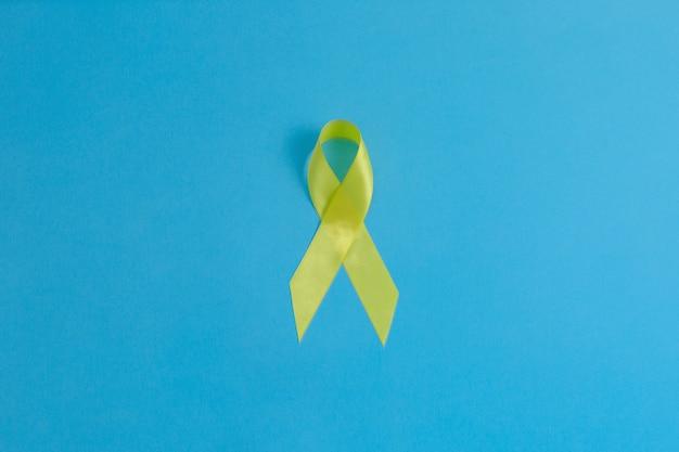 Geel lint blaaslever en botkanker bewustzijnssymbool