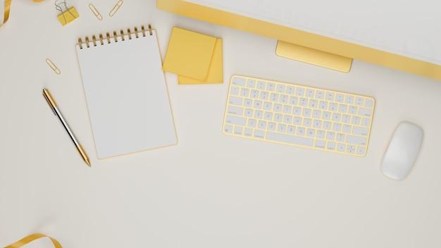 Geel pastel computerapparaat met accessoires en briefpapier op witte tafel,