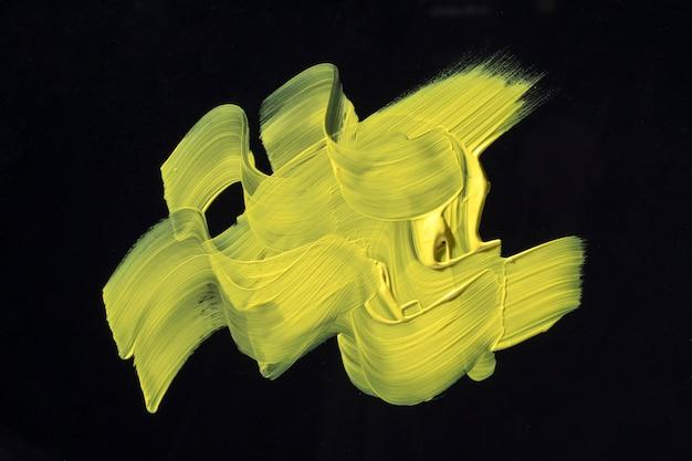 Geel penseelstreek abstract ontwerp
