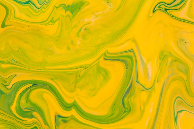 Geel vloeibaar acryl giet schilderij