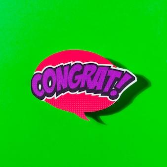 Gefeliciteerd tekstballon komische explosie pop-art stijl op groene achtergrond