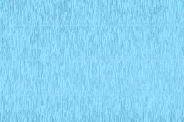 Gegolfd papier textuur. blauw cyaan kunst papier textuur. lichtblauw papier textuur met gegolfd oppervlak. abstracte achtergrond