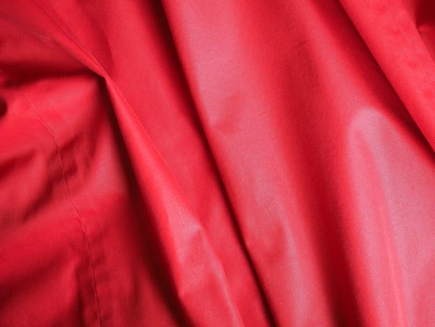 Gegolfde rode polyester stof textuur achtergrond