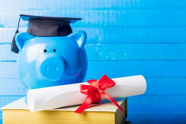 Gegradueerde student diploma spaarvarken