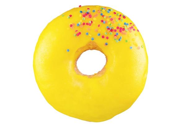 Geïsoleerde donut met gele glazuur, besprenkeling. op de stapel geschoten. gefotografeerd door te stapelen.