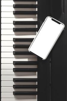 Geïsoleerde smartphone scherm op piano